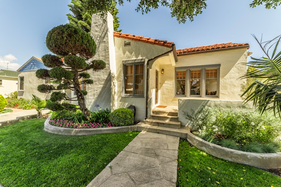 Walk to abbot kinney in a flash from this spanish bungalow for Spanish bungalow house plans