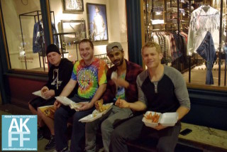 Dudes enjoing their food on First Fridays